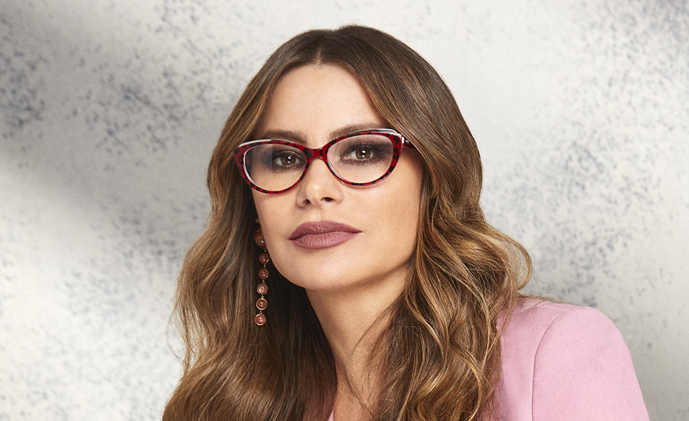 Woman in pink wearing glasses