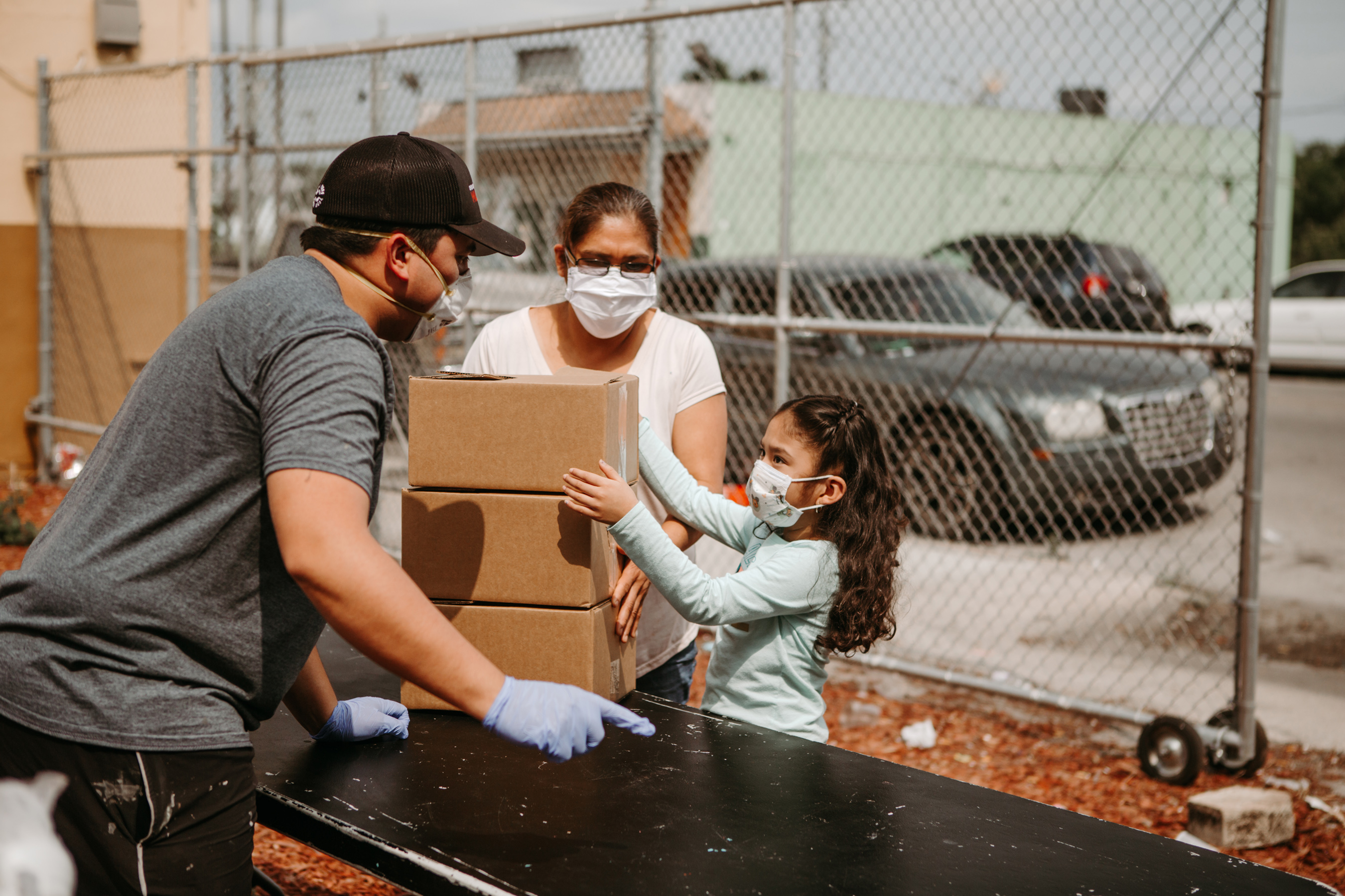 """Boxes of food are distributed to families as part of Convoy of Hope's """"50 Million Meals and Counting"""" COVID-19 response."""