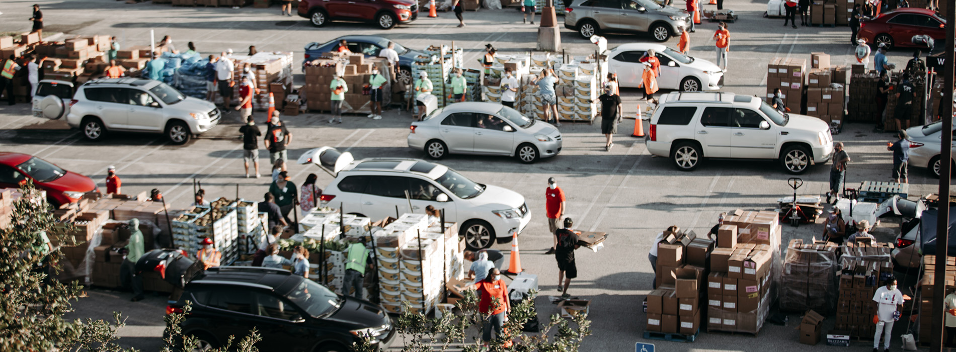 Volunteers load hundreds of cars at a point of distribution with much needed food and supplies from Convoy of Hope.