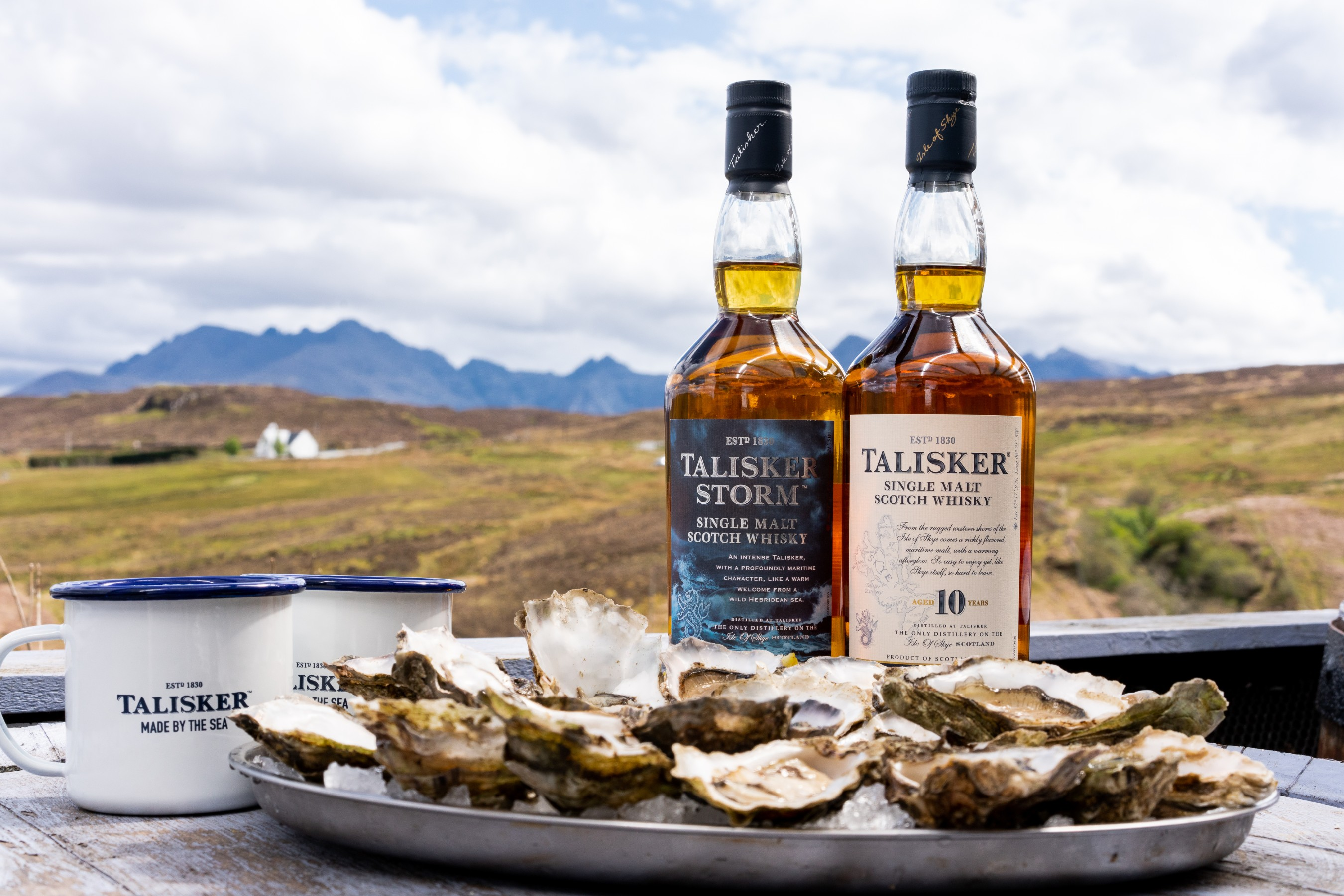 Made by the sea on Scotland's strikingly beautiful Isle of Skye, the Talisker distillery is battered by wind and waves on the rugged coastline where oysters are locally farmed & enjoyed. The waters from the nearby sea create the Single Malt's signature maritime and briny notes – making Talisker and oyster pairings a local favorite. #ShuckFromHome. Photo Credit: Philip Edsel.