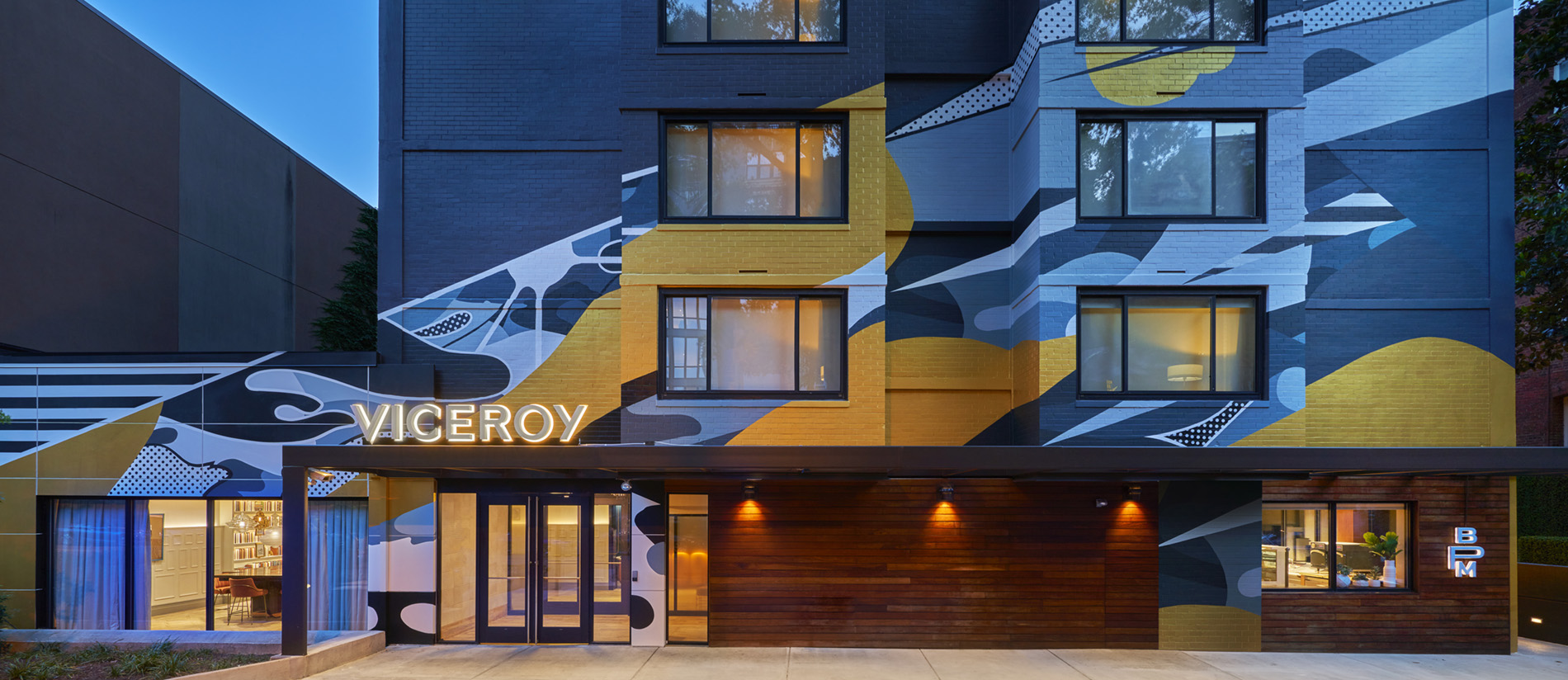 A striking mural by local artist Brandon Hill, co-founder of No Kings Collective, greets guests and neighbors. Photo Credit: Mike Schwartz Photography