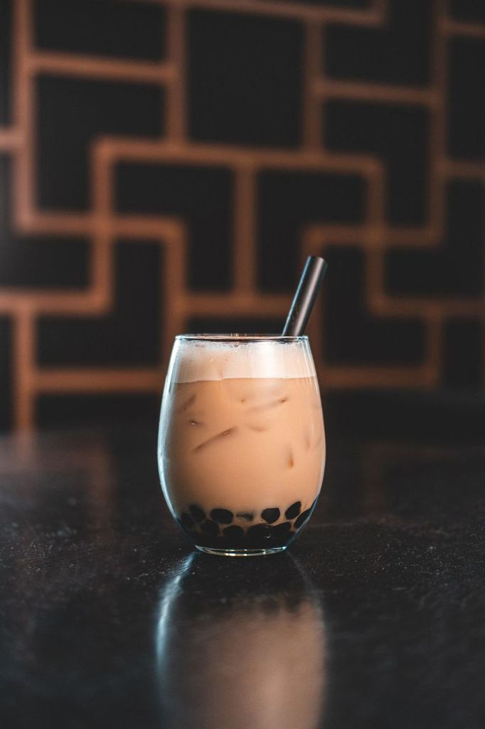 The Spiced Boba, the first of Din Tai Fung's seasonal boba cocktails, is made with dark rum, ginger syrup, half and half, black tea, angostura bitters and a scoop of Din Tai Fung's signature boba pearls.