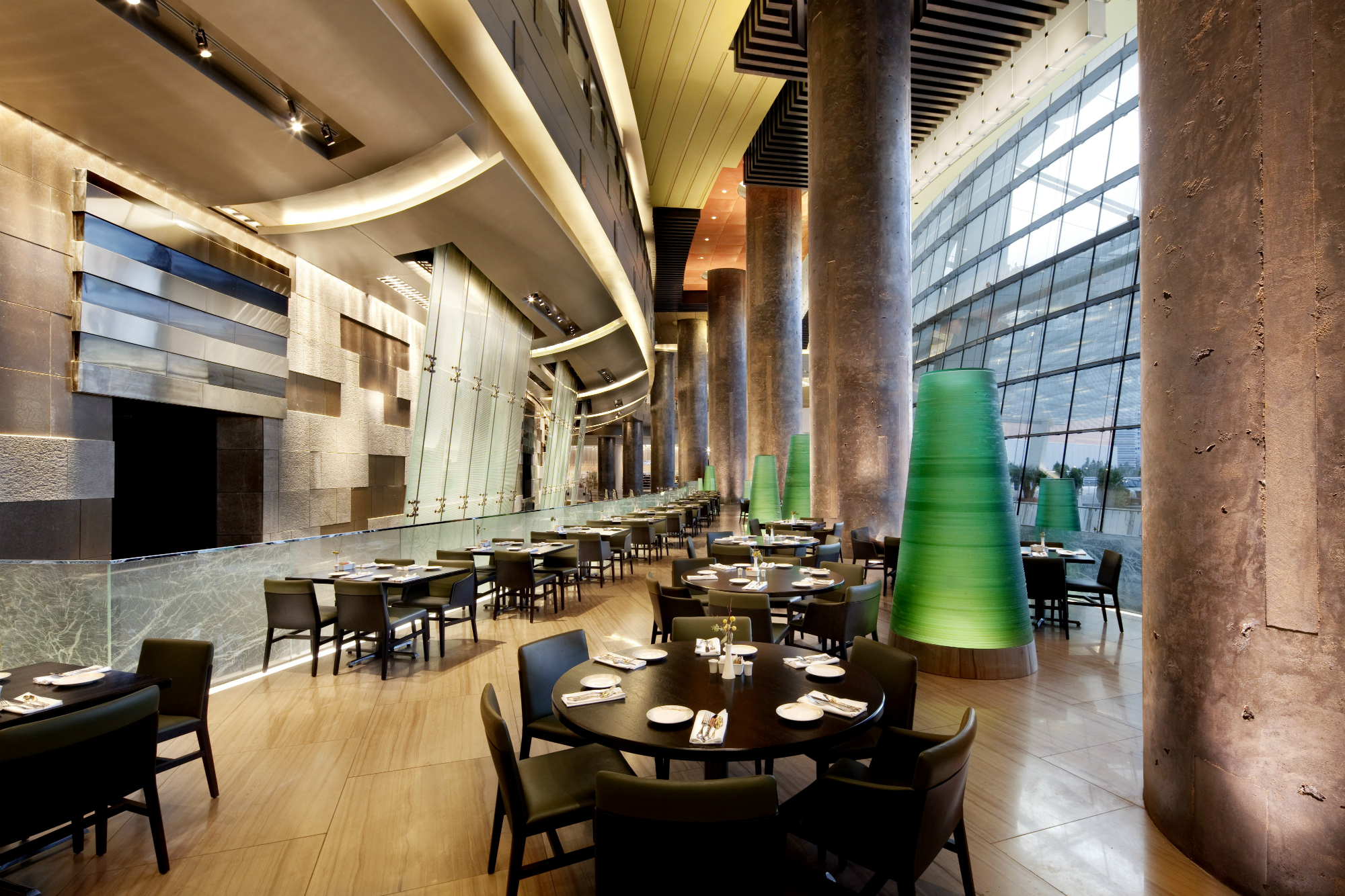 "Din Tai Fung's dining room features a soaring 40-foot glass wall which floods the space with natural light and offers a view of Nancy Rubin's ""Big Edge"" art installation."