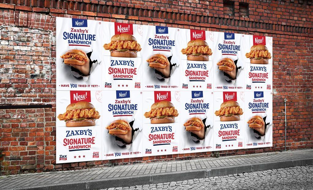 Guerilla-style wild postings are popping up in test markets in keeping with Zaxby's war-themed campaign for its new Signature Sandwich.