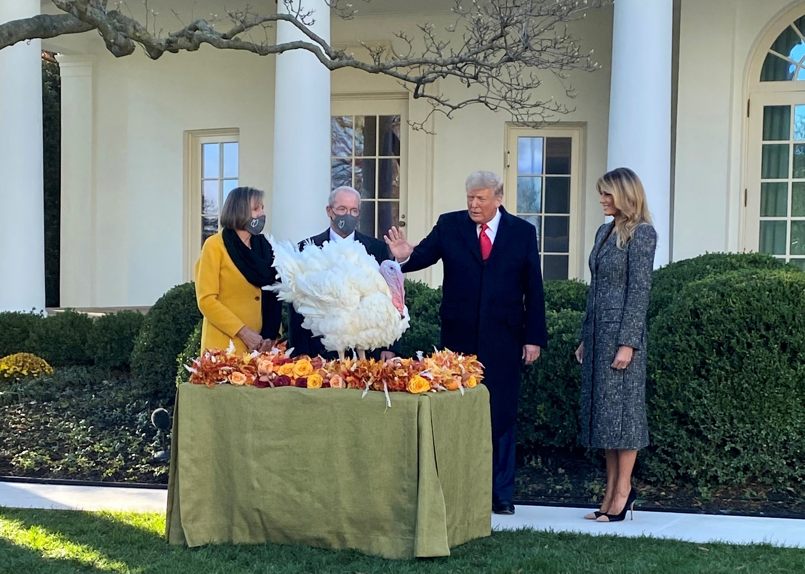 NTF Chairman Ron Kardel, his wife, Susie, and the First Lady look on as Corn is officially pardoned by President Trump.
