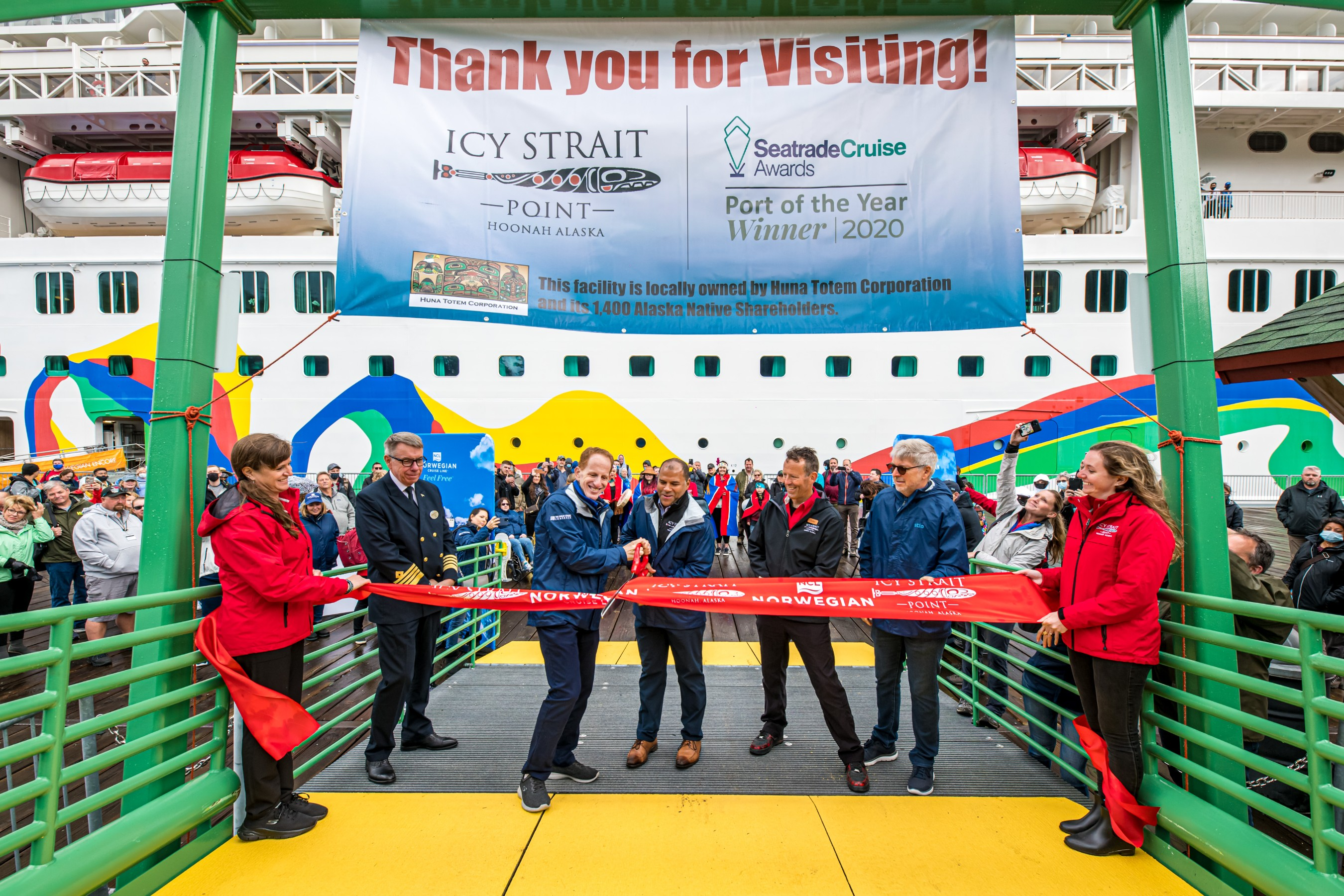 A ribbon cutting ceremony was held on Aug. 10, 2021 in Icy Strait Point, Alaska to celebrate the opening of the new Wilderness Landing pier built in partnership with Norwegian Cruise Line Holdings Ltd. and Huna Totem Corporation. NCL President and CEO Harry Sommer and Huna Totem Corporation CEO Russell Dick ceremoniously cut the ribbon and open the new pier. Photos by Alive Coverage.