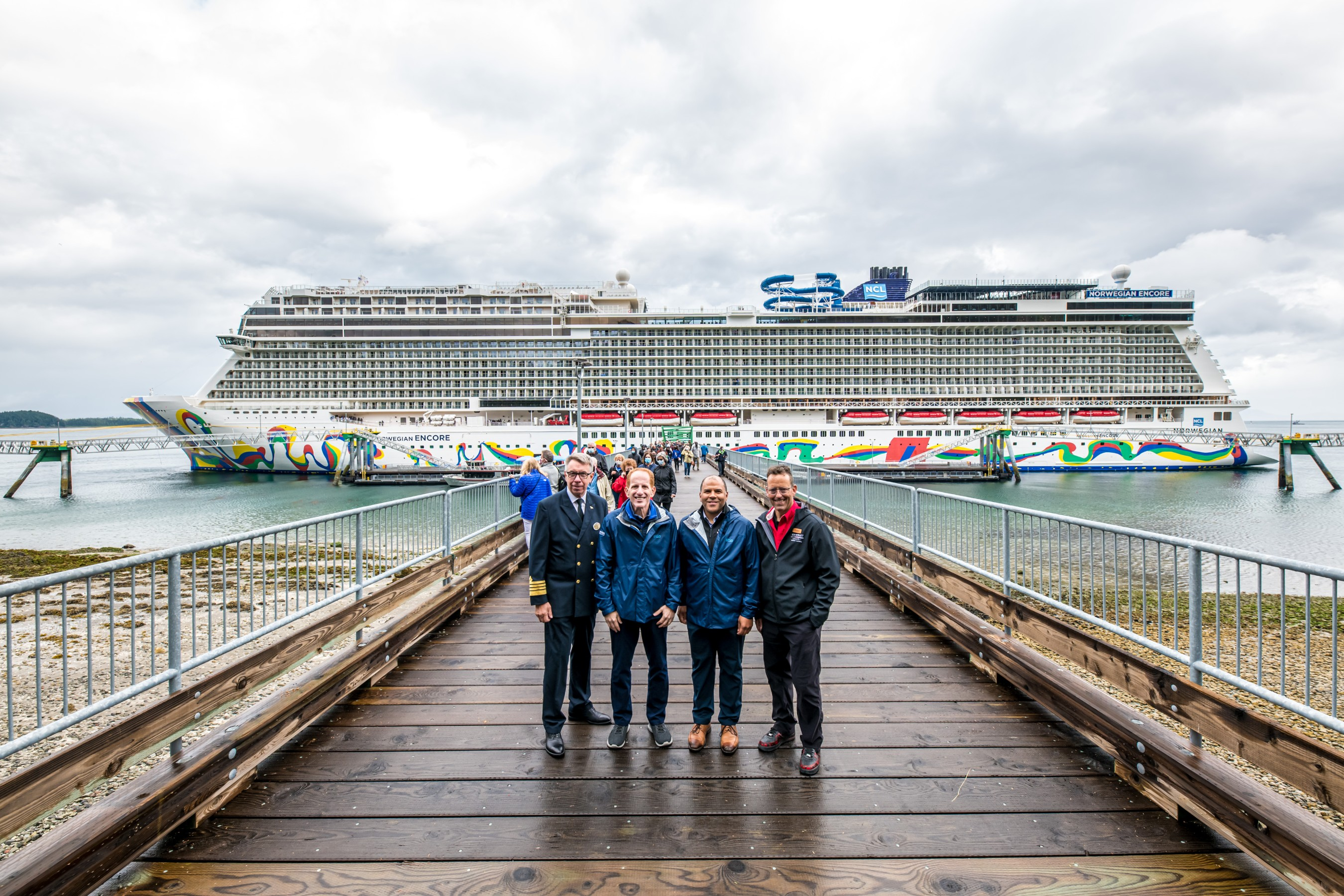 Norwegian Cruise Line makes its Great Cruise Comeback from the U.S. with Norwegian Encore's debut voyage to Alaska, where Icy Strait Point was the first port of call. Pictured here on the new Wilderness Landing pier, which was built in partnership between Norwegian Cruise Line Holdings Ltd. and Huna Totem Corporation, are Norwegian Encore Captain Martin Holmqvist, NCL President and CEO Harry Sommer, Huna Totem Corporation CEO Russell Dick and Tyler Hickman, Vice President of Huna Totem Corporation. Photos by Alive Coverage.