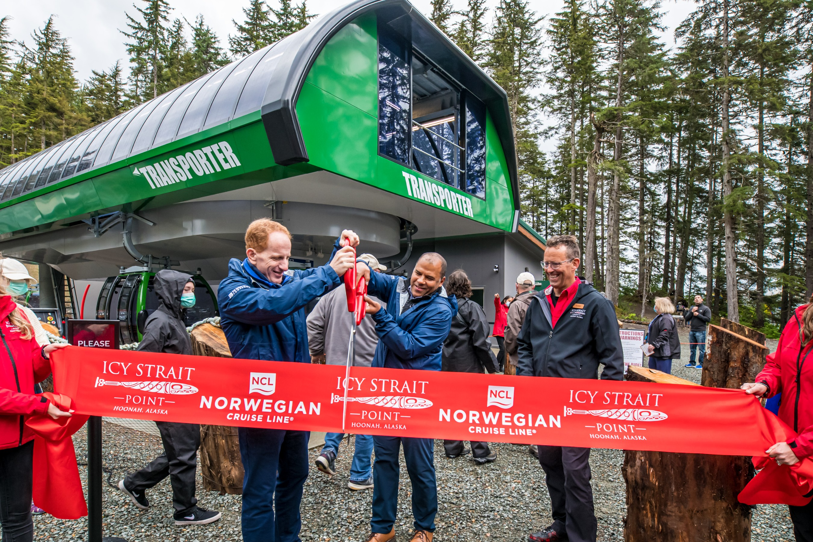 NCL President and CEO Harry Sommer and Huna Totem Corporation CEO Russell Dick ceremoniously cut the ribbon for the opening of the new Transporter Gondola system at Icy Strait Point, Alaska on Aug. 10, 2021 during the Cruise Line's first voyage to Alaska after its 500-day pause in operations. Photos by Alive Coverage.