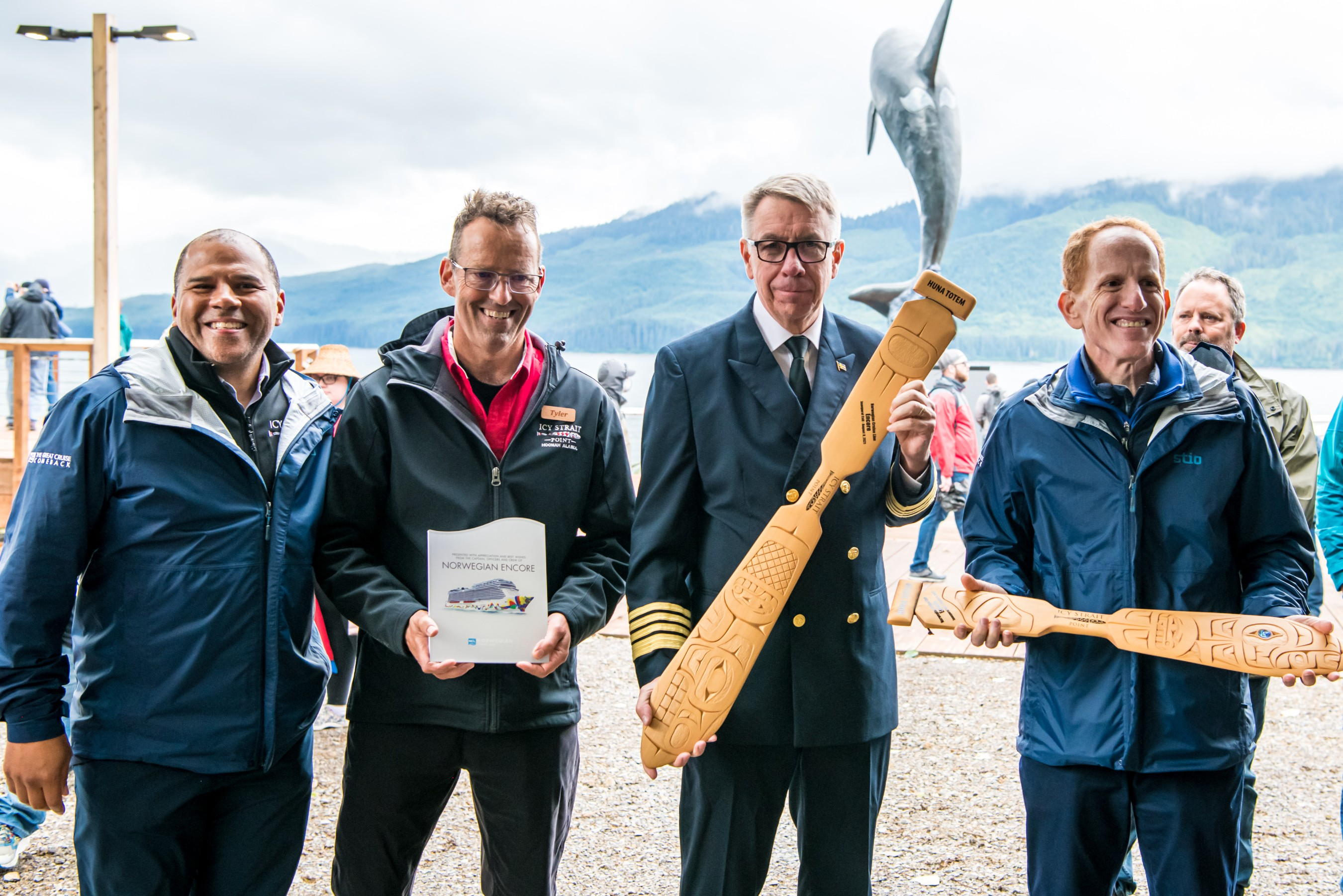 Norwegian Cruise Line and Huna Totem Corporation host ceremonial plaque exchange during Norwegian Encore's debut call to Icy Strait Point, Alaska. In attendance were CEO of Huna Totem Corporation Russell Dick, Vice President of Huna Totem Corporation Tyler Hickman, Norwegian Encore Captain Martin Holmqvist and NCL President and CEO Harry Sommer. Photos by Alive Coverage.