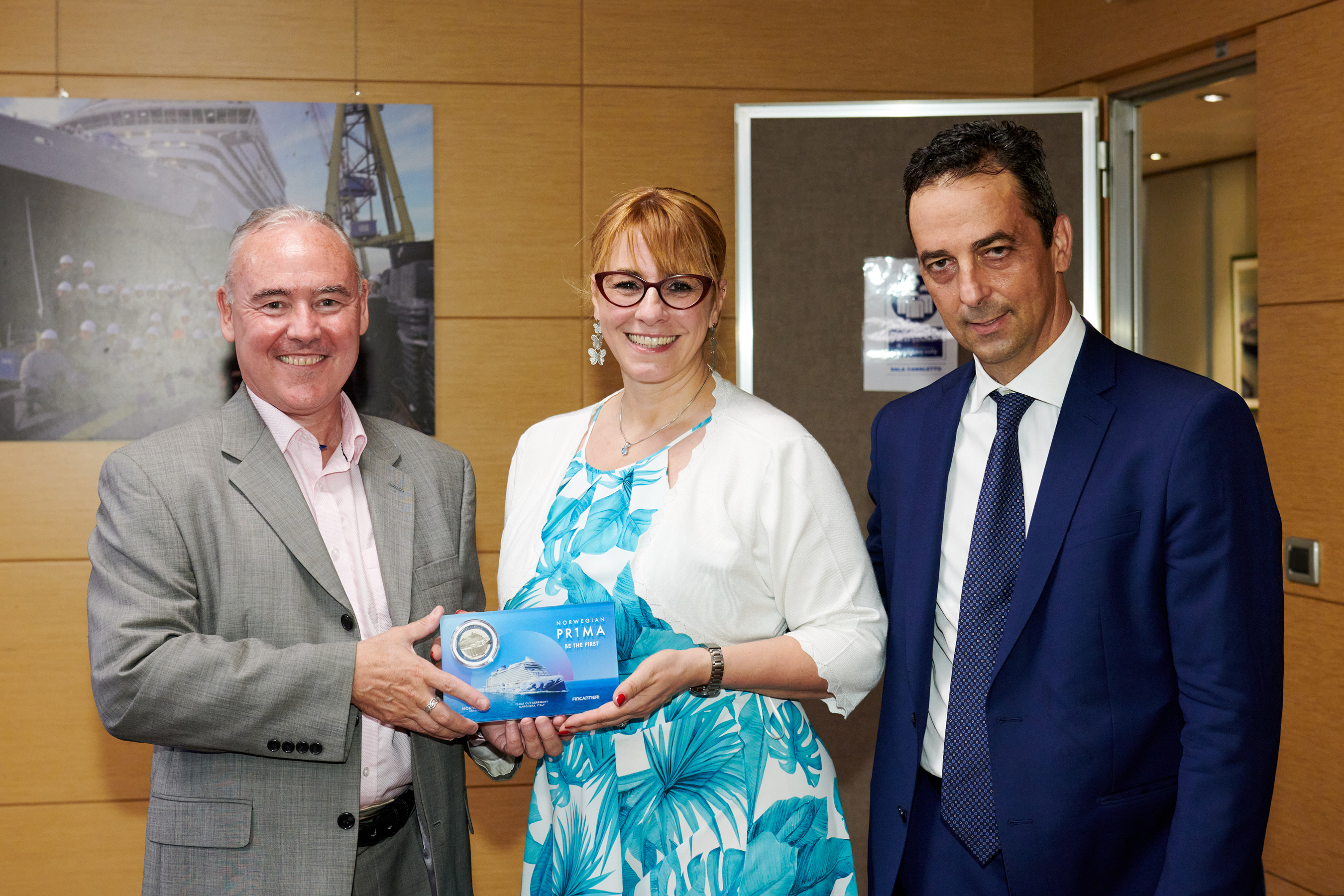 Eamonn Ferrin, Vice President of International Business of Norwegian Cruise Line, Tatiana Lazzarin, Shipyard Godmother and Head of Machinery Room Outfitting Technical Office of Fincantieri, and Antonio Quintano, Fincantieri Marghera Shipyard Director, attend the traditional coin ceremony for Norwegian Prima, soon-to-be the newest ship in the NCL fleet. Photo by ©Filippo Vinardi