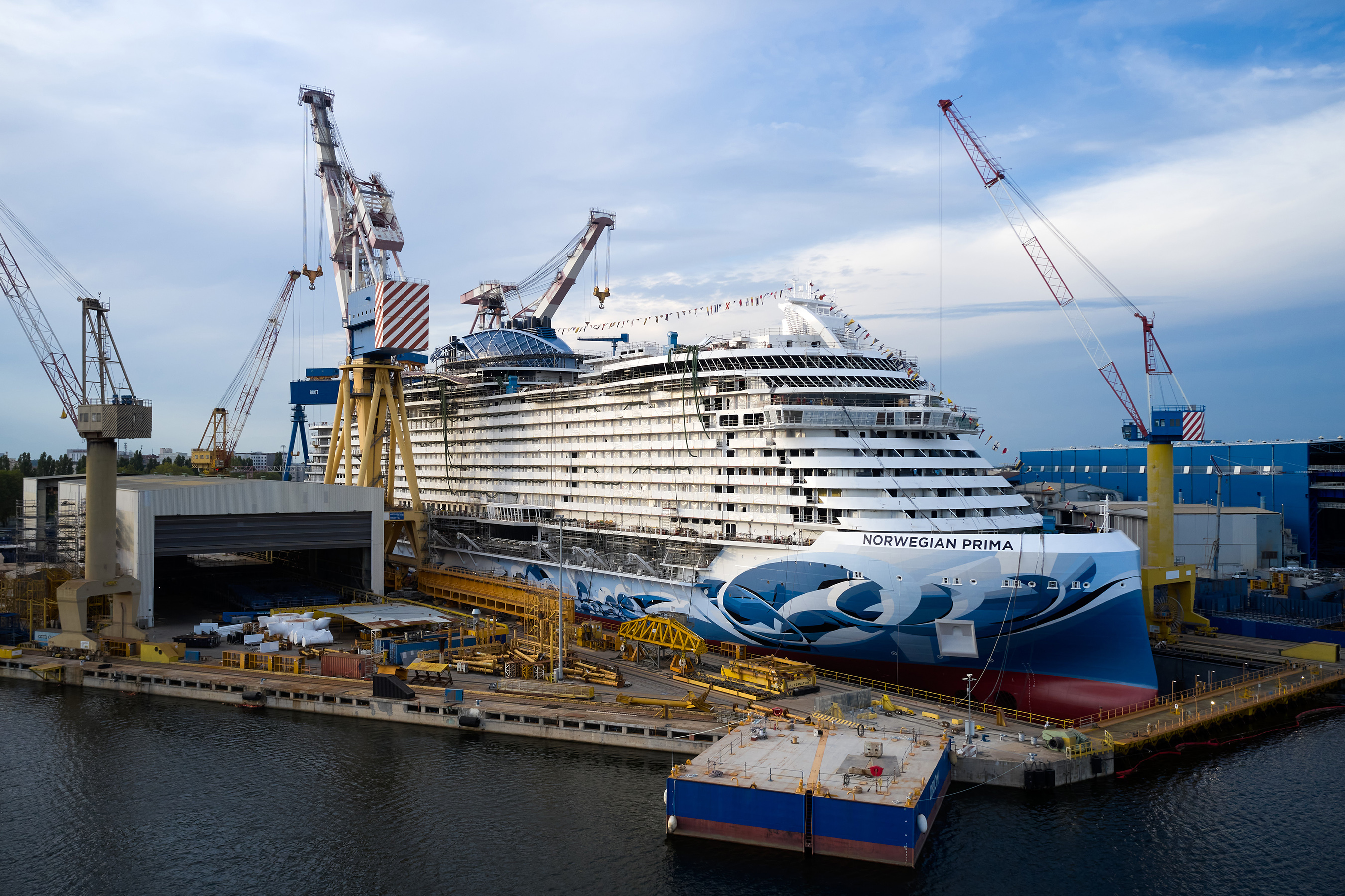 Norwegian Prima, the first of six ships within NCL's all new Prima Class, floats out from her dry dock at Fincantieri shipyard in Marghera, Italy, on Aug. 11, 2021, marking a major construction milestone and the first time the new vessel touches water. Photo by ©Filippo Vinardi