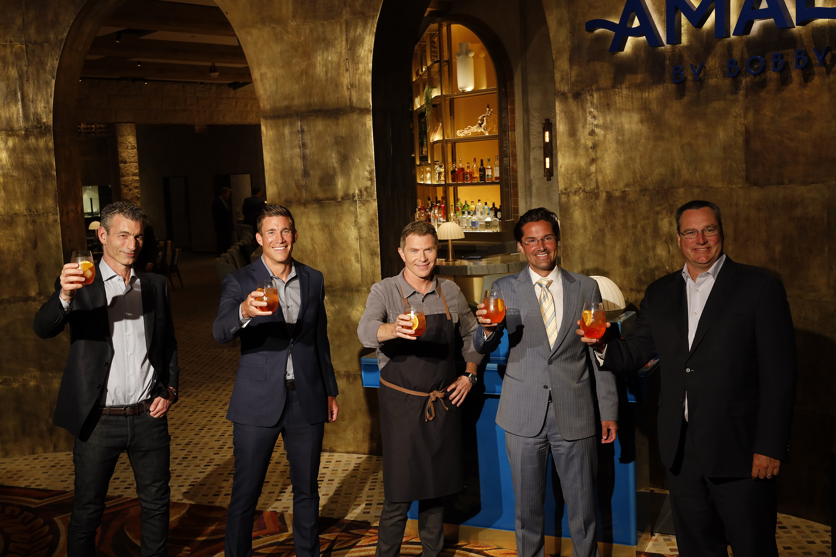 (L to R) - Business Partner Laurence Kretchmer, Caesars Entertainment President & COO Anthony Carano, Chef Bobby Flay, Caesars Entertainment Regional President Sean McBurney, Caesars Entertainment CEO Tom Reeg at the Amalfi by Bobby Flay Grand Opening Event at Caesars Palace Las Vegas