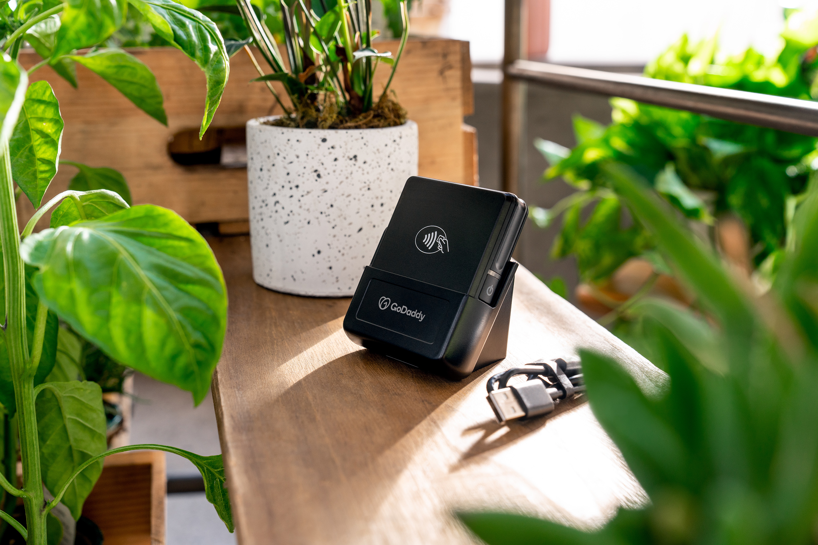 GoDaddy Card Reader comes with a free docking station and has a battery that lasts all day.