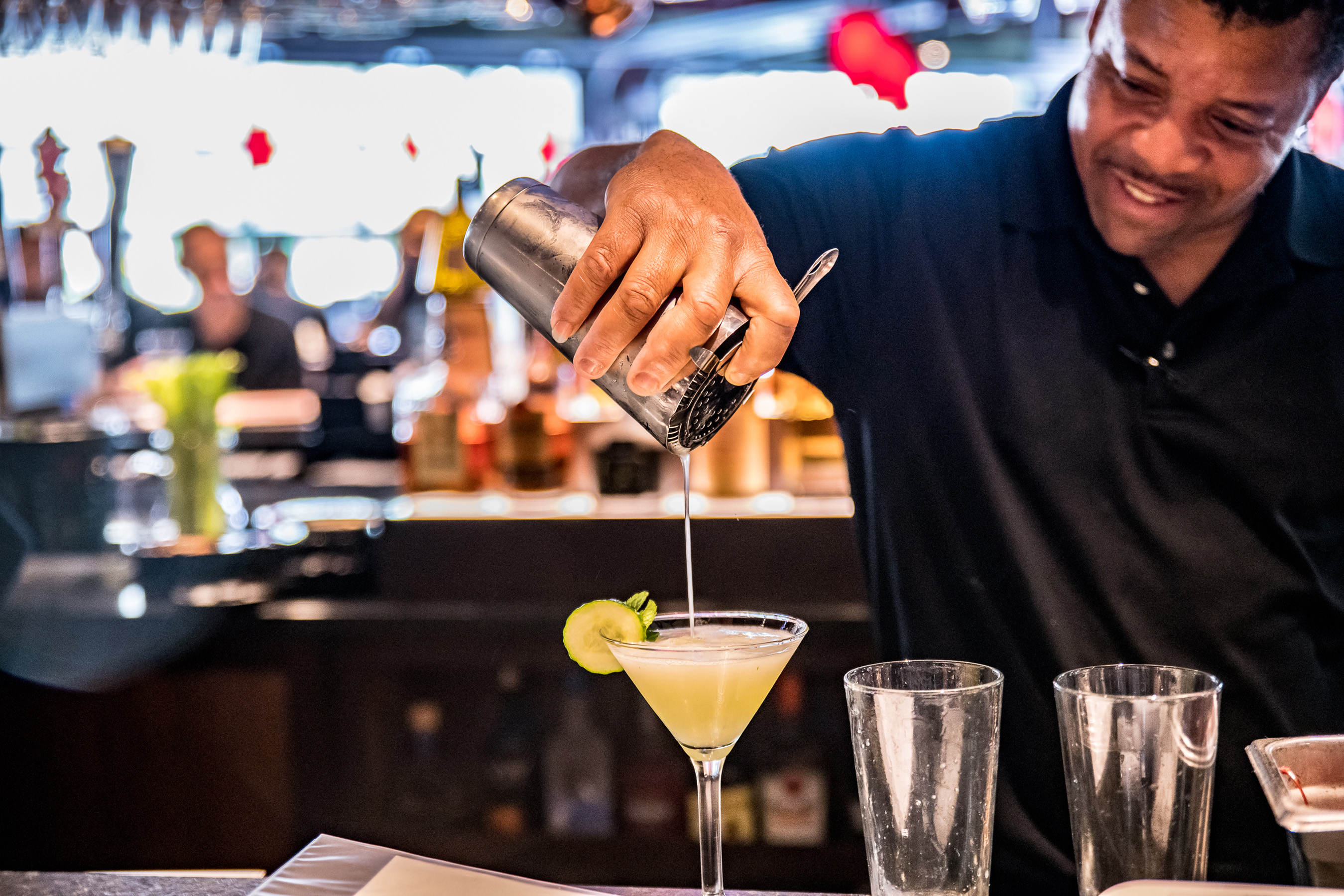 This Bar Louie bartender completes the finishing touch on one of their classic signature cocktails, the EFFEN Good martini. July 2019.