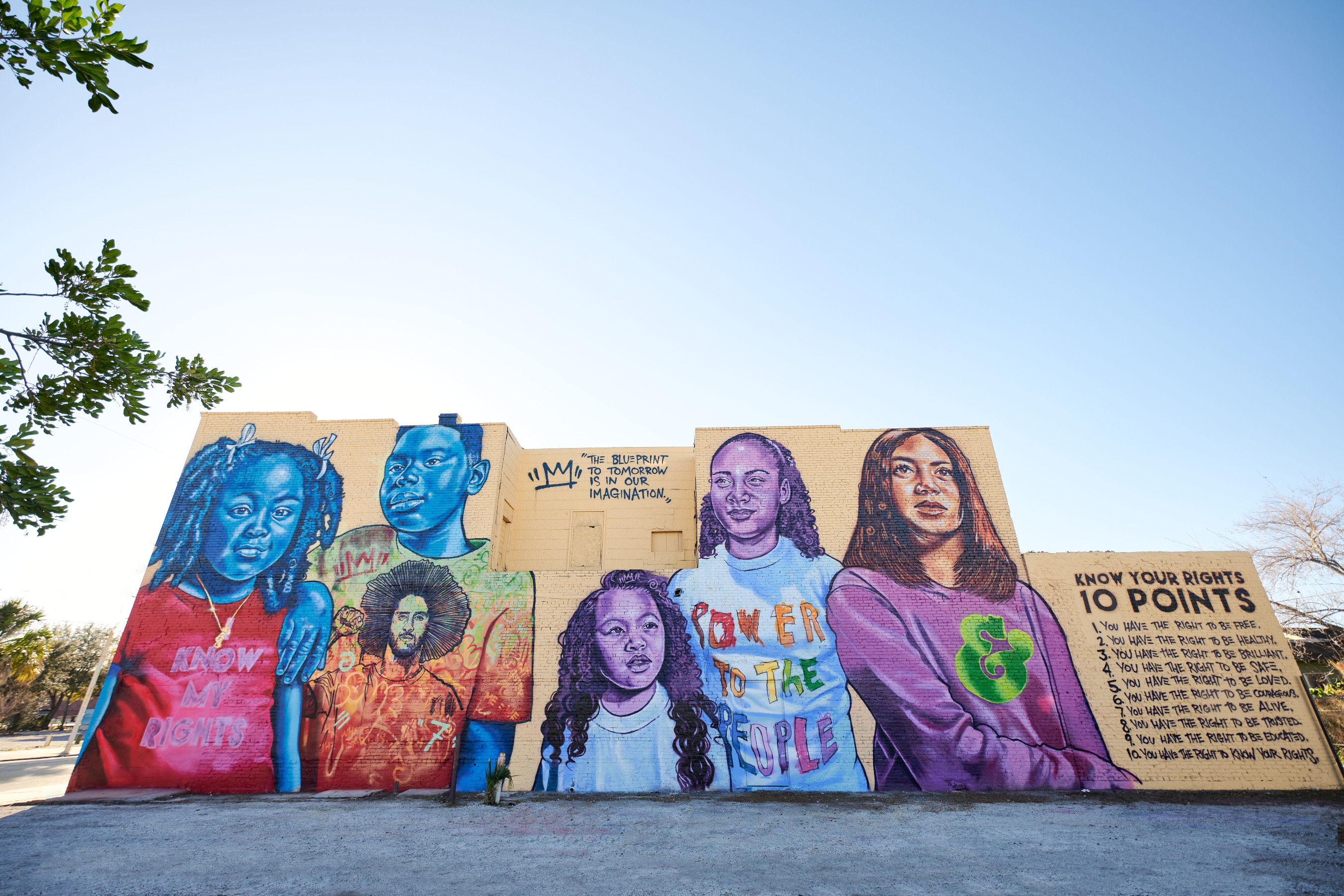 """Change the Whirled"" was unveiled in Tampa today to honor Colin Kaepernick's courageous fight against police violence and systemic racism. The mural was a collaboration among Ben & Jerry's, Colin Kaepernick's Know Your Rights Camp, and artist Brandan ""BMike"" Odums."