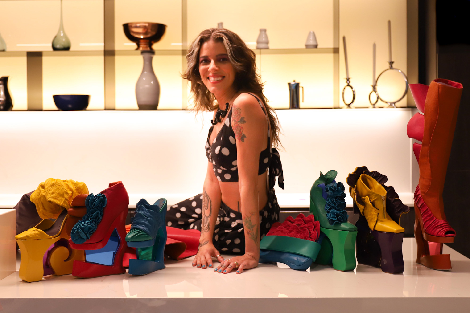 Bell Quintão with her designs | Photo Credit: Abayomi Bellamy