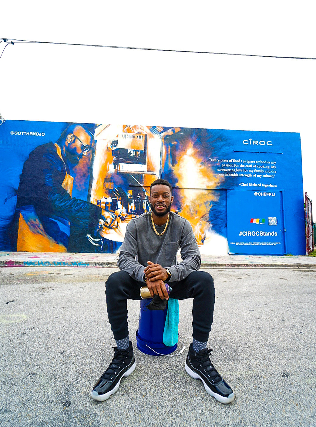 Artist Mojo In Front of #CIROCStands Mural Of Richard Ingraham To Celebrate Black Excellence
