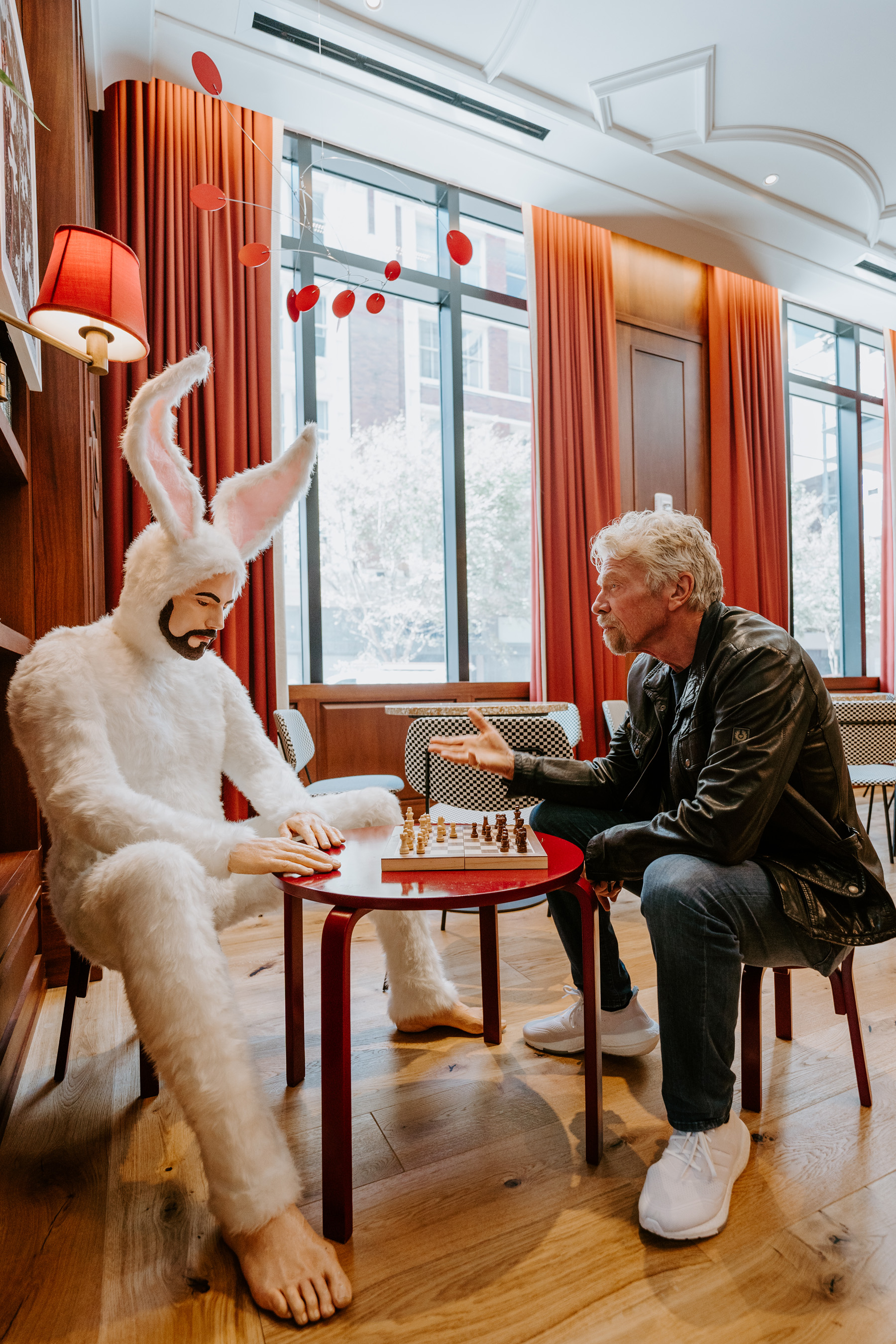 Sir Richard Branson and Bunnyman chatting at the Funny Library Coffee Shop at Virgin Hotels New Orleans