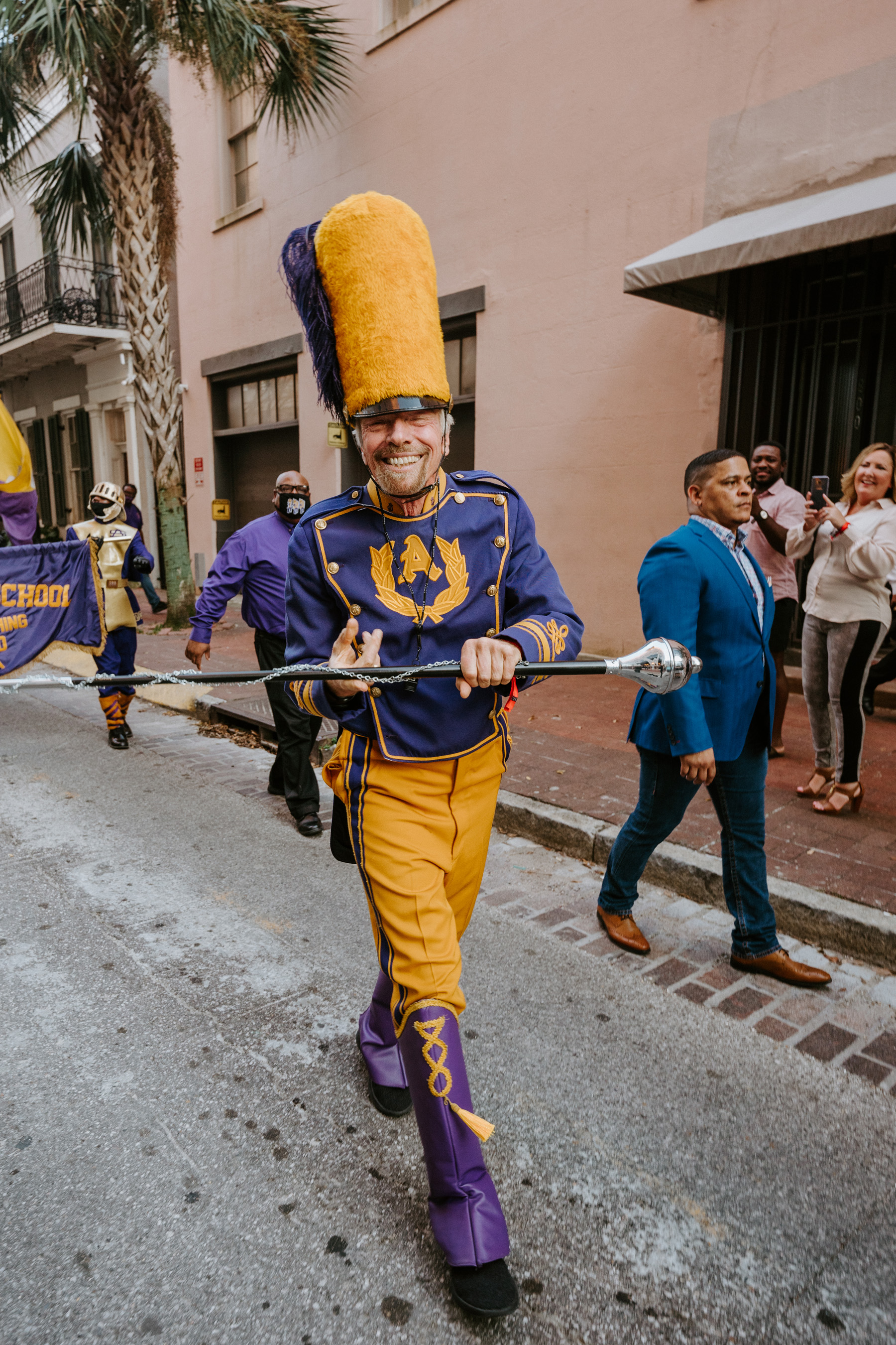 Sir Richard Branson steps it up with the Saint Augustine High School Marching 100 marching parade to Virgin Hotels New Orleans Grand Opening Celebration.