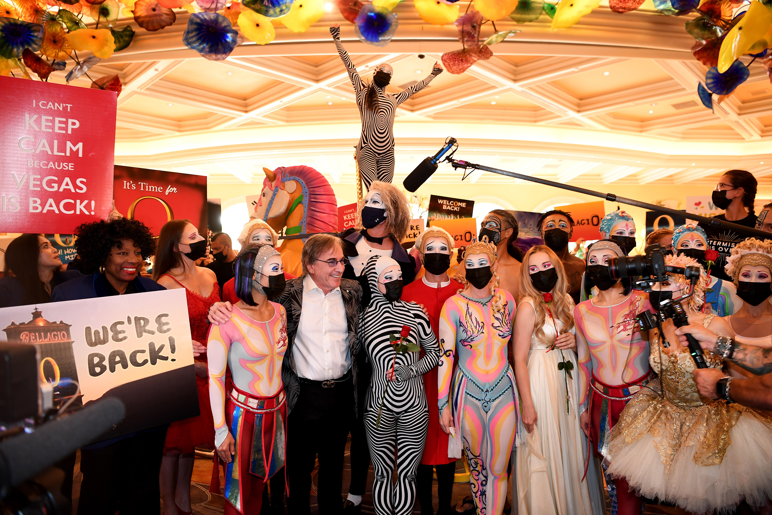 """""""O"""" by Cirque du Soleil cast and crew members delight guests at Bellagio as they parade through the resort on reopening night in Las Vegas, July 1, 2021"""