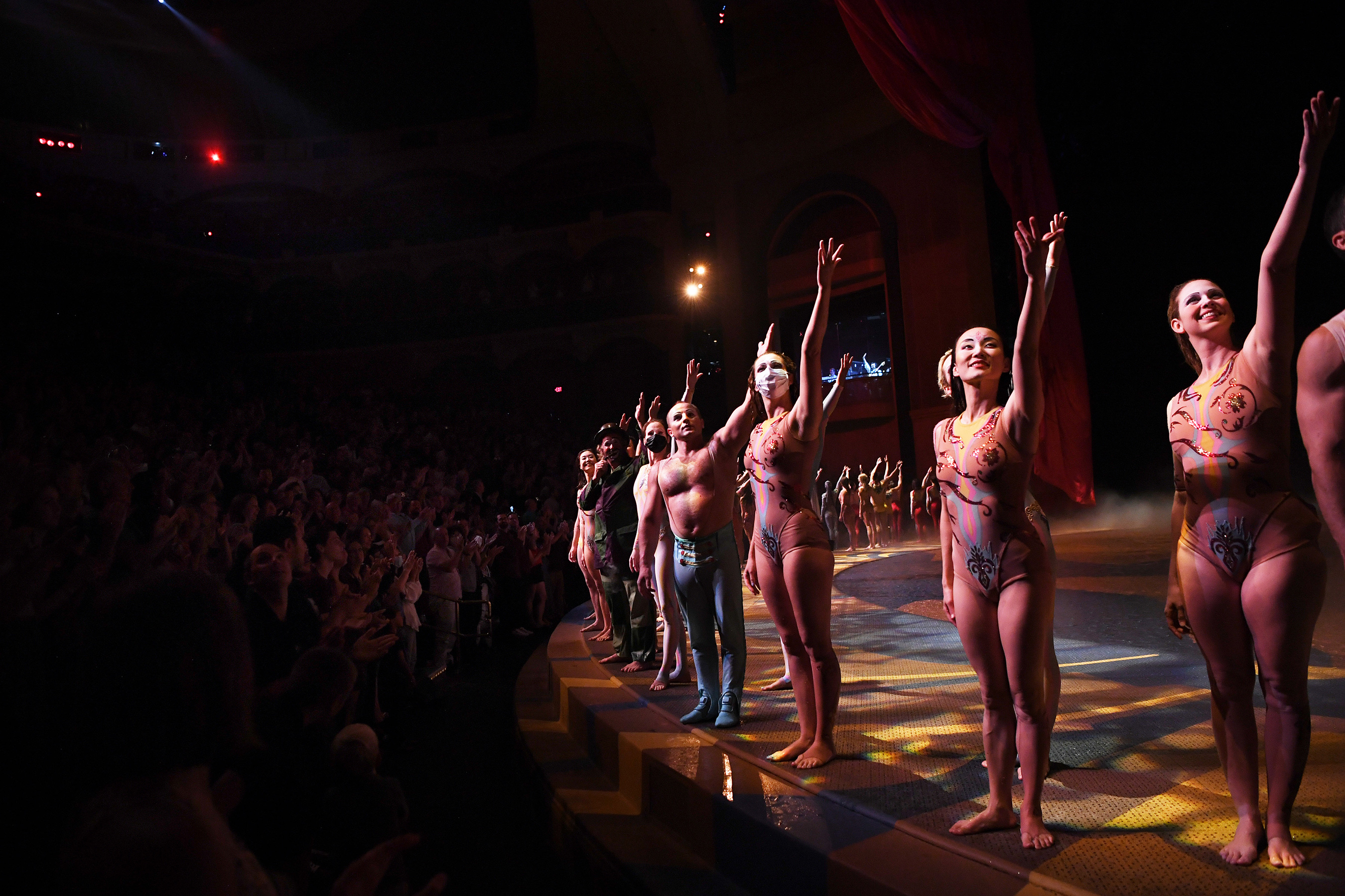 """A sold-out crowd gives """"O"""" by Cirque du Soleil cast and crew members a standing ovation on their reopening night, July 1, 2021"""