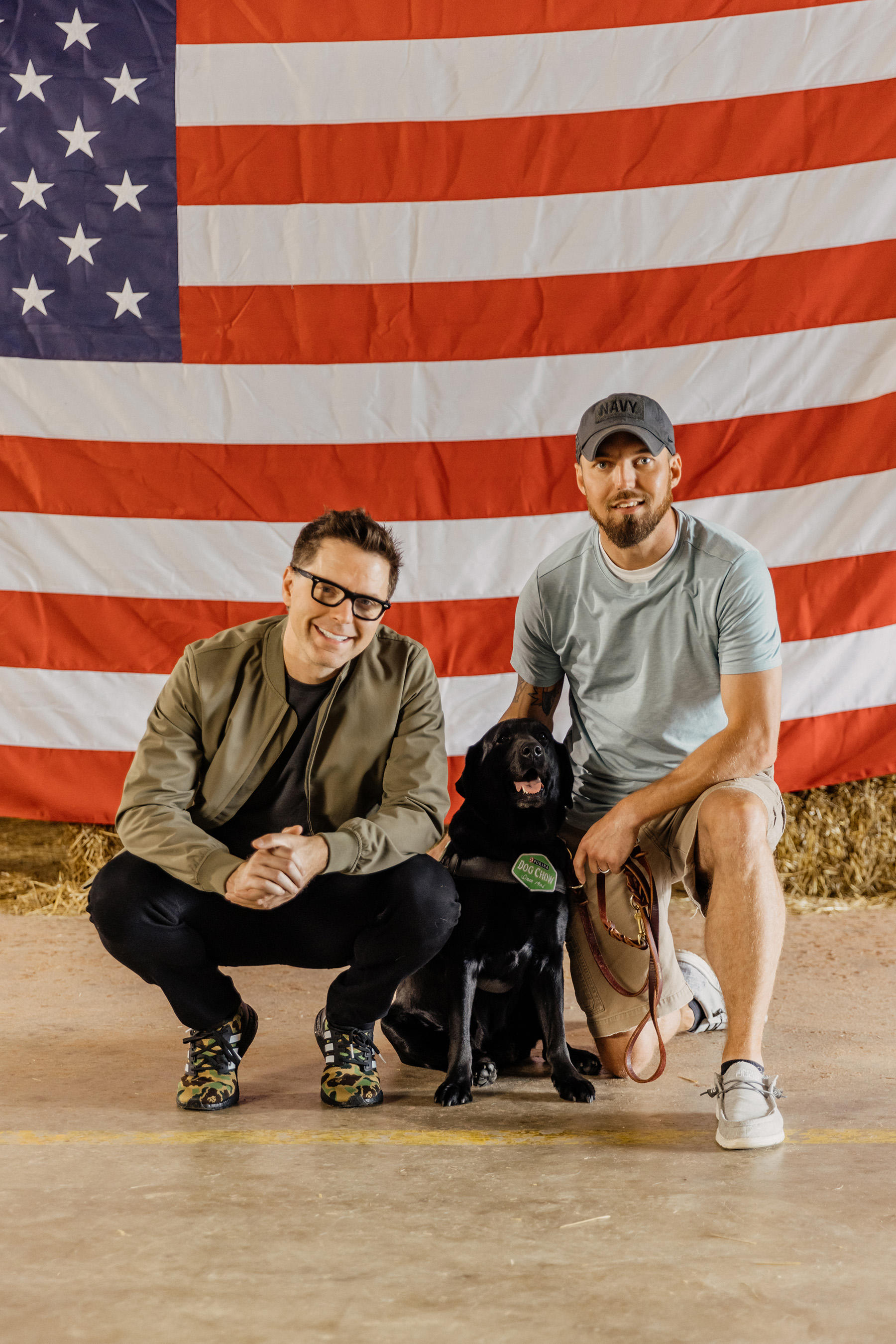 Dog Chow partner and TV/radio personality Bobby Bones with Veteran Andy and his service dog Thanos participate in the fourth annual Dog Chow Service Dog Salute campaign
