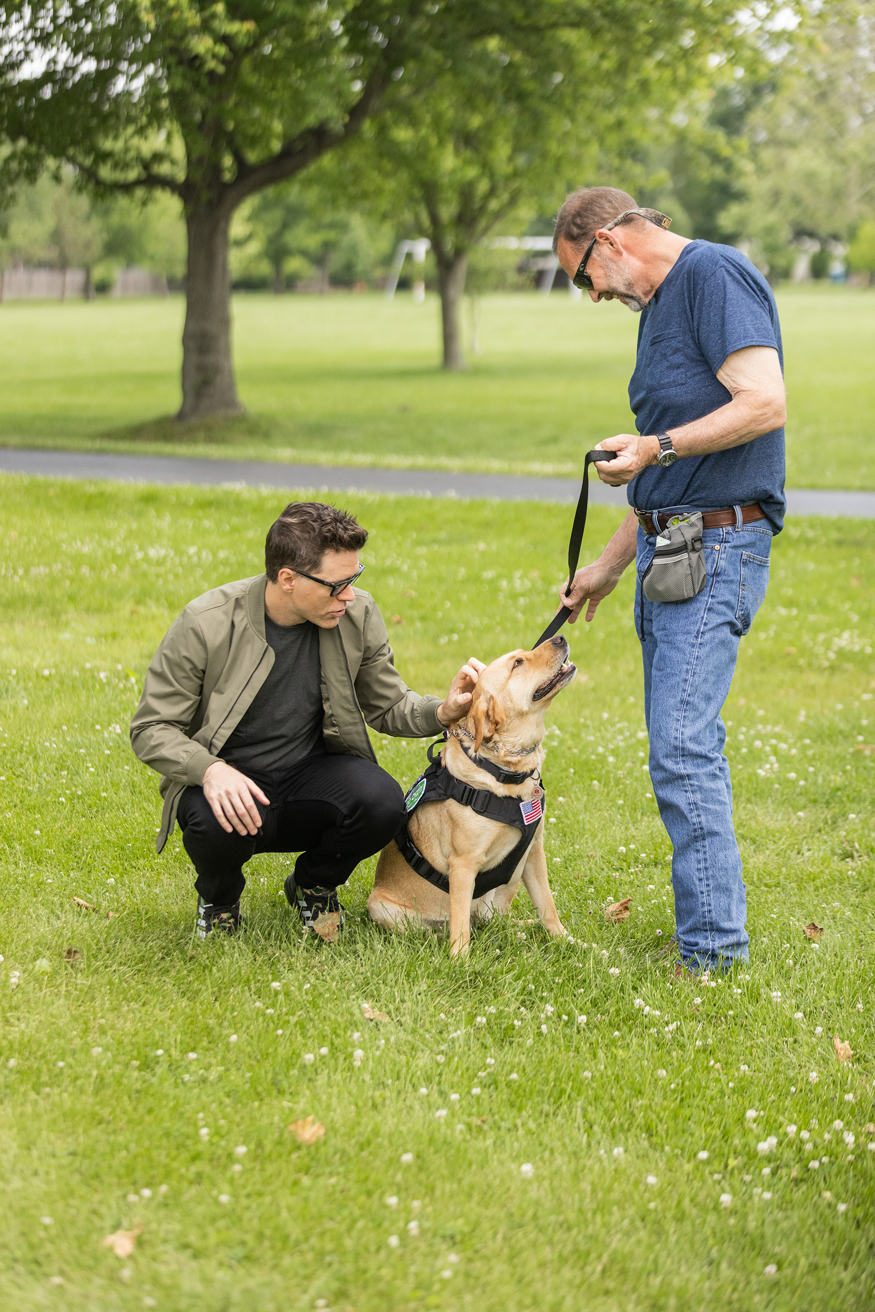 Dog Chow partner and TV/radio personality Bobby Bones with veteran Shannon and his service dog Pepper participate in the fourth annual Dog Chow Service Dog Salute campaign