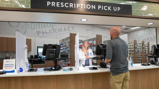 Man speaks to a pharmacist about free prescription