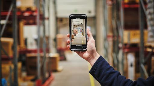 Image of a warehouse. In the warehouse, read NFC tags, or use one-button scanning to track virtually anything. The high-res rear/front cameras capture detailed images.