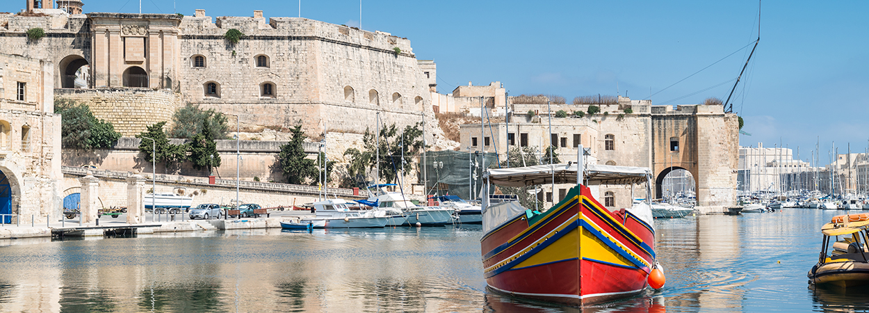 Image of traditionally painted passenger boat vittoriosa